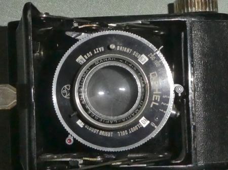 Dehel 6x4.5 folding camera, lens/shutter detail - with Sunny 16 calculator www.oldcamera.blog